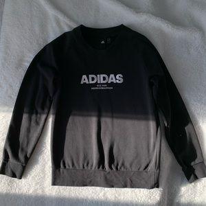An Adidas black sweeter. Size medium.